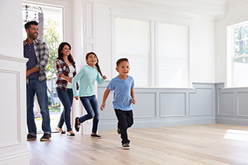 young family entering new home for first time